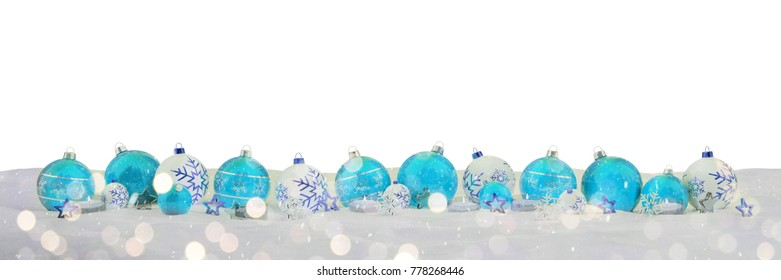 Blue and white christmas baubles and candles on snow background 3D rendering