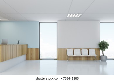 Blue and wooden hospital lobby with a reception desk and white chairs for patients waiting for the doctor visit. 3d rendering mock up