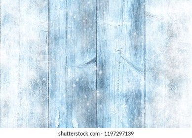Blue wooden table, snowy winter background, texture