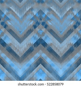 Blue zig zag chevron watercolor pattern abstract. Pale color blue Ethnic  pattern overlay on zig zag background. Pastel blue geometric watercolor seamless.