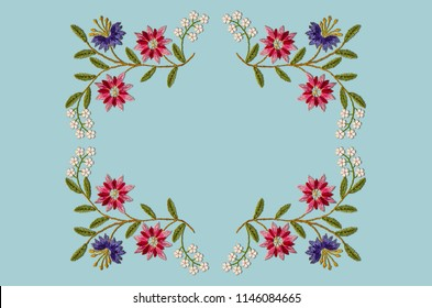 Bluish background with  pattern for embroidery satin stitch an square frame of branches with purple and red cornflowers and gentle white flowers