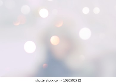 blur background image of winter time or with bokeh and people background usage concept. defocused modern interior.