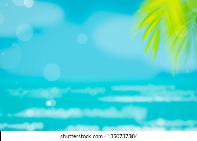 Blur beautiful nature green palm leaf on tropical beach with bokeh sun light