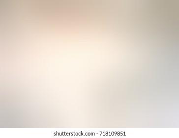 Blurred grey beige background. Defocused grunge background. Empty pale dust texture. Vintage texture. Abstract design. Retro background.