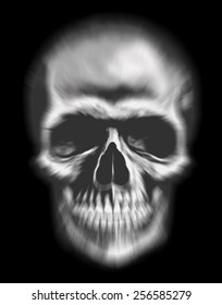 blurred human skull as symbol of fear and death with black background