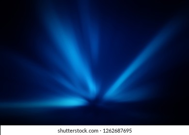 Blurred rays of light abstract blue background