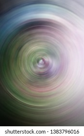 blurred spiral abstract with blue purple green white and grey