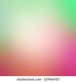 Blurred spring colors of hot pink salmon peach and mint green.  Colorful blurry background with smooth shiny texture.