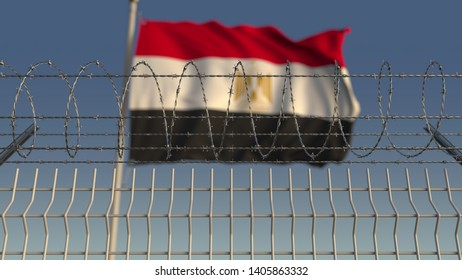 Blurred waving flag of Egypt behind barbed wire fence. 3D rendering