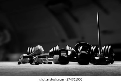 Bodybuilding equipment on concrete floor. Black and white illustration.