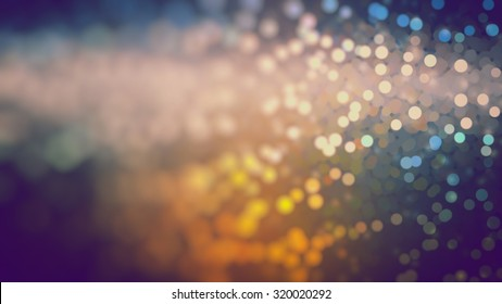Bokeh light, shimmering blur spot lights on multicolored abstract background.