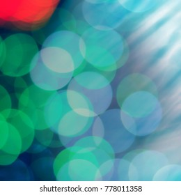 BOKEH VIVID COLOR BACKGROUND. ABSTRACT BEAUTIFUL DEFOCUSED LIGHT BACKGROUND. CHRISTMAS BACKGROUND.