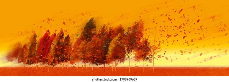 Bold and bright colors of orange autumn leaves are seen on a line of trees leaning in a strong wind blows the leaves across the image.