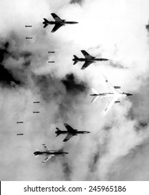 Bombing North Vietnam. US Air Force F-105 Thunderchief bomb a military target through low clouds over the southern panhandle of North Viet Nam. June 14,1966.