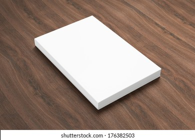 Book with blank cover isolated on wooden background