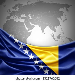 Bosnia and Herzegovina flag of silk with copyspace for your text or images and world map background -3D illustration