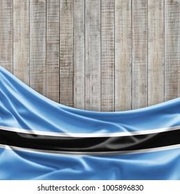 Botswana flag of silk and wood background -3D illustration