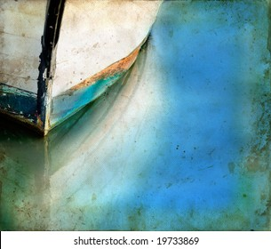 Bow of an old boat reflecting in the water. Copy-space for your own text.