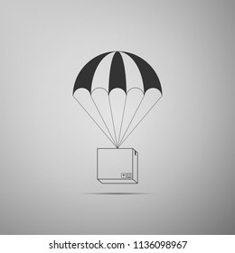 Box flying on parachute icon isolated on grey background. Parcel with parachute for shipping. Delivery service, air shipping concept, bonus concept. Flat design