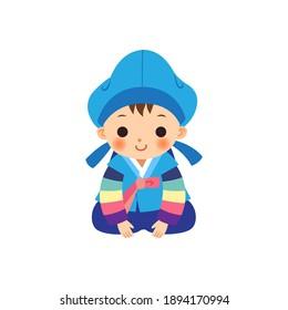 Boy wearing Korean traditional costume Hanbok. New Year greetings.