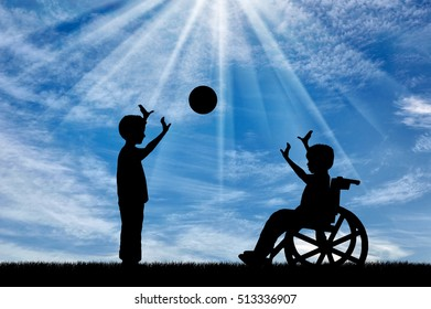 Boy in wheelchair playing with boy in ball day. Concept happy child disabled