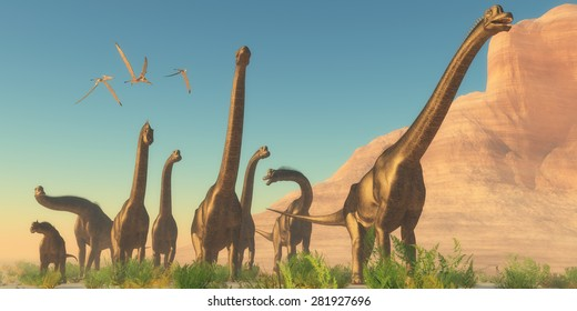 Brachiosaurus Afternoon - Three Pteranodon flying reptiles watch as a herd of Brachiosaurus dinosaurs travel near a canyon mountain.