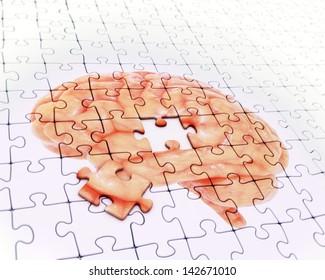 Brain jigsaw puzzle - memory concept illustration
