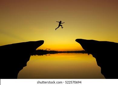 Brave men. jump through the gap between hill. Fearlessly men jump through the gap between hill. Business concept idea