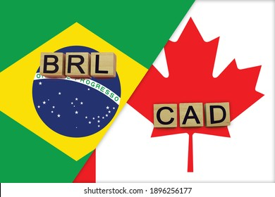 Brazil and Canada currencies codes on national flags background. International money transfer concept
