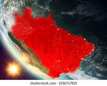 Brazil during sunset highlighted in red on planet Earth with clouds. 3D illustration. Elements of this image furnished by NASA.