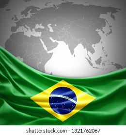Brazil flag of silk with copyspace for your text or images and world map background -3D illustration