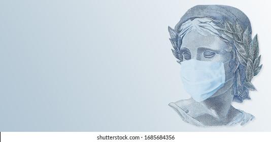 Brazilian effigy in Coronavirus Covid19 mask. Brazilian money. Concept of economy crisis. Pandemic influencing the world economy. Brazilian Money.