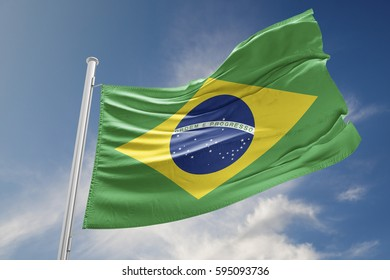 Brazilian flag is waving at a beautiful and peaceful sky in day time while sun is shining. 3D Rendering