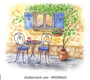 Breakfast on the street under the window. A table and chairs outside on the street. Coffee and croissant. Watercolor landscape in the style of Provence.
