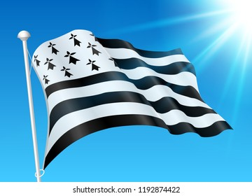 Breton flag on wind with sunshine and blue sky background