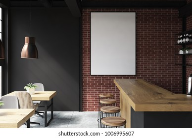 Brick and black loft bar interior with a concrete floor, a bar with stools and wooden tables with chairs. A poster. 3d rendering mock up