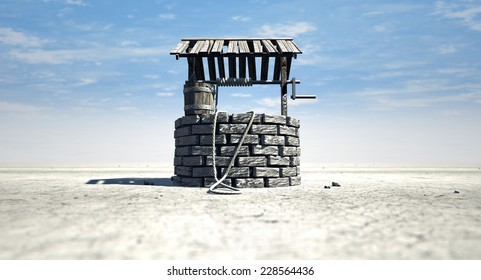 A brick water well with a wooden roof and bucket attached to a rope in a flat barren landscape with a blue sky background