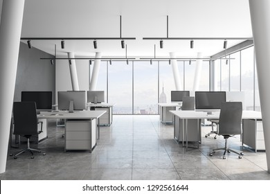Bright coworking office interior with New York city view and daylight. 3D Rendering