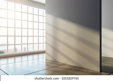 Bright interior with empty concrete wall, window with city view and sunlight. Gallery and presentation concept. Mock up, 3D Rendering