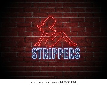 Bright neon sign of a sexy naked female stripper on a brick wall at night.