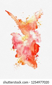 Bright orange red and yellow abstract watercolor splashes on white textured paper