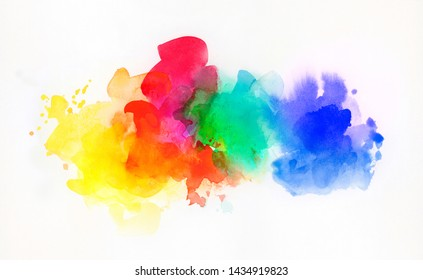Bright rainbow colored watercolor paints and different colorful textures combined and isolated on white paper. Art, craft, creativity, concept, background.
