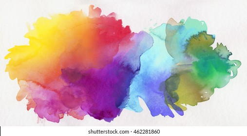 bright rainbow colored watercolor paints on white paper