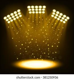 Bright stadium spotlights on dark gold background