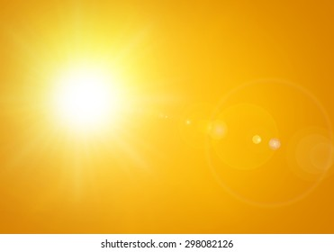 bright sun with lens flare in orange background
