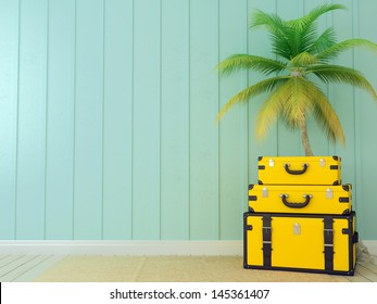 Bright yellow bags on the background of blue wall and a beautiful palm tree