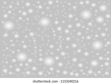A brilliant gray background with circles. Template for a holiday card with bright and sparkling lights.