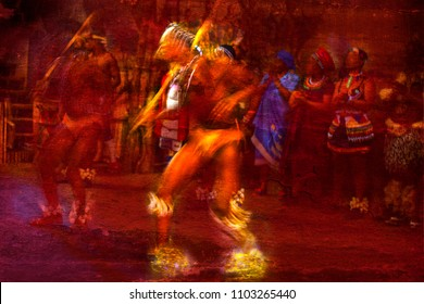 Brilliantly colored African Dancers in motion against a red textured background