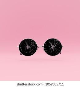 Broken glasses on pastel pink background minimal concept. 3d