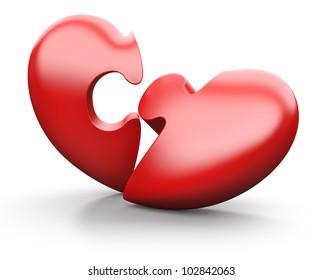 Broken jigsaw heart, isolated on white